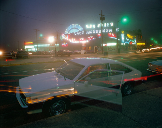 Palace Amusement, Asbury Park, New Jersey, 1980, by Joe Maloney. Digital archival pigment print of night view of parked car and glowing park rides.