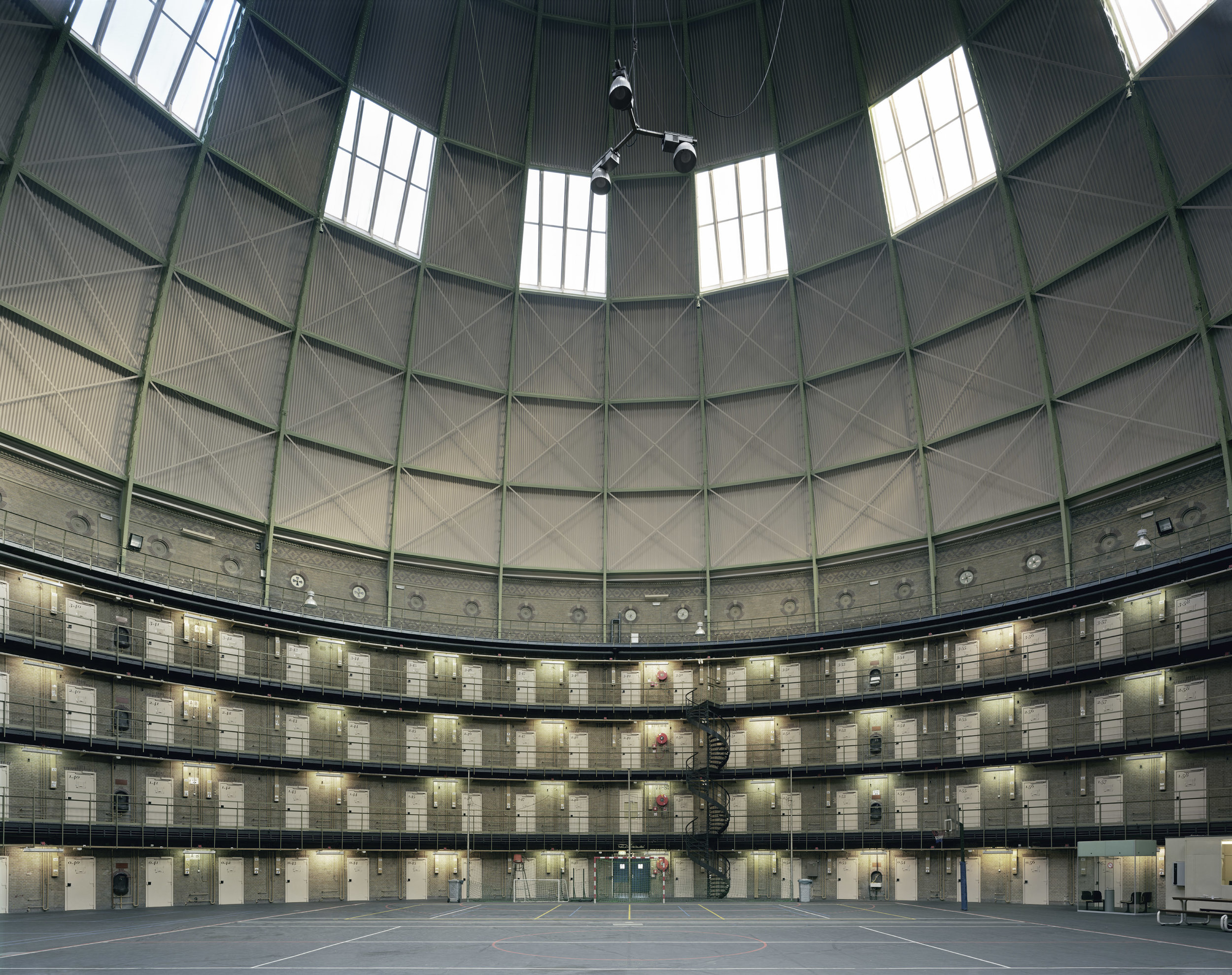Haarlem Prison, Haarlem, Netherlands, 2009, by David Leventi. Fujicolor Crystal Archive print on Dibond of the interior and roof of the prison.