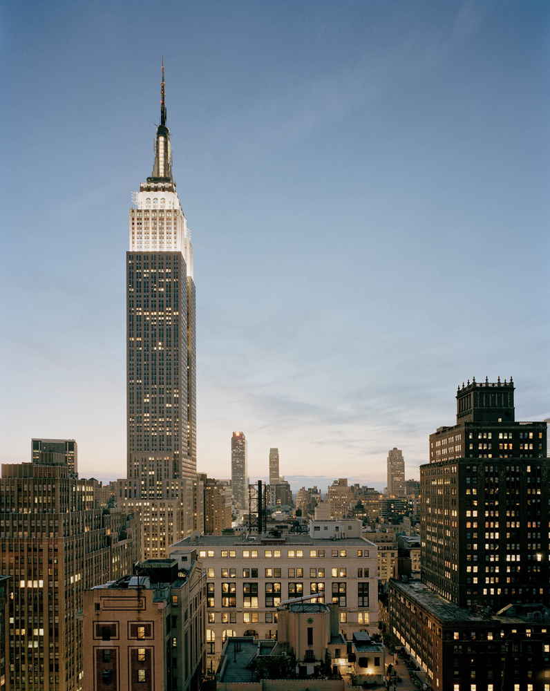 Empire State Building, 350 Fifth Avenue, New York, New York, 2005 -2007, by David Leventi. Print on Dibond of building's exterior and lights at dusk.