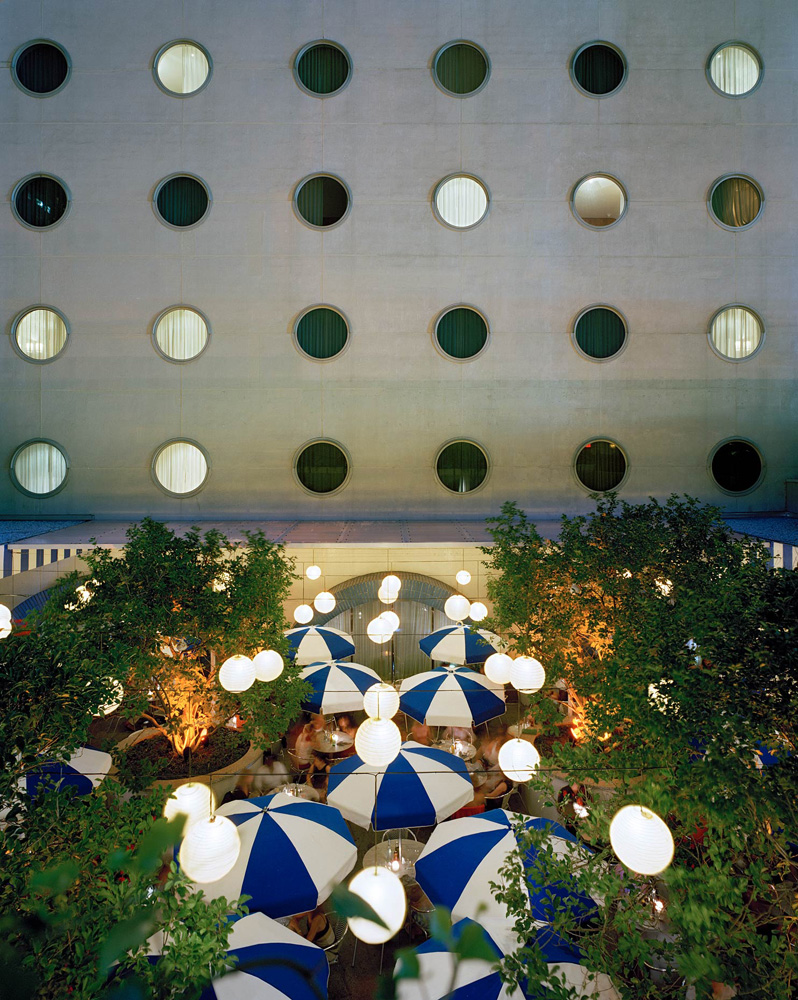 Maritime Hotel, 363 West 16th Street, Chelsea, New York, 2005-2007, by David Leventi. Dibond print of hotel at night, with umbrellas and tree décor.