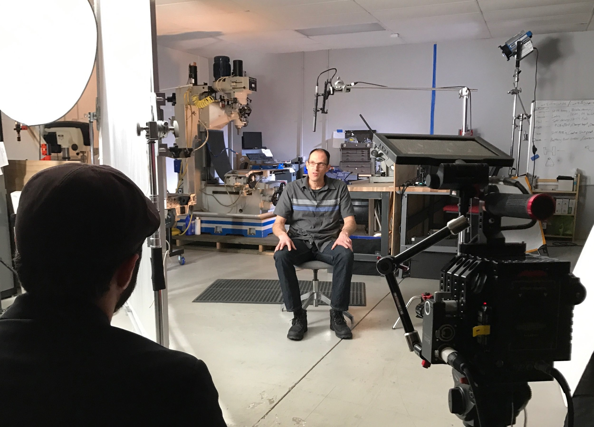 Seth Schaeffer, President and CEO of Hoptocopter™ Films, interviewing a Canvas employee on set in Boulder, Colorado.