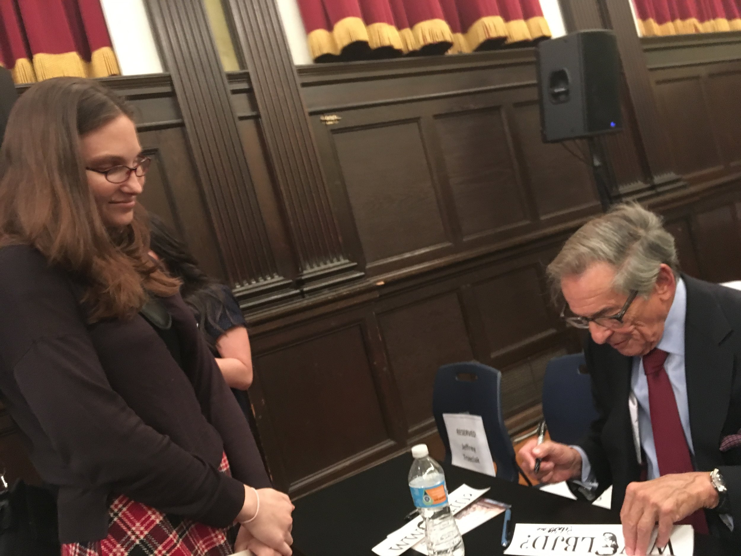 I look very shy and dopey in this photo but look how dapper Mr. Caro looks as he signs this bumper sticker!