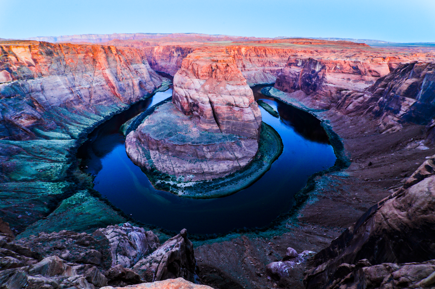 Horseshoe Bend (Page, Arizona). Horseshoe Bend is a scenic area where the Colorado River decided to change paths creating this world famous bend. Getting there at 5:00 am to beat the crowd proved to be a good move as just 20 minutes after sunrise the rim was packed. This is not for the faint of heart as there is no railing and no safety nets. Just two feet in front is a several hundred foot drop. This is something I have wanted to shoot for years and excited to get it done.