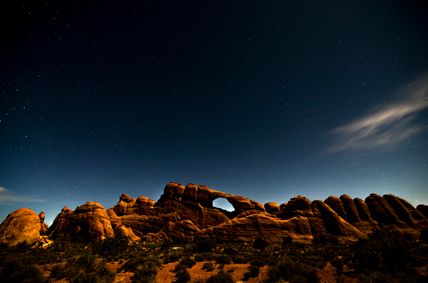 This was shot in Arches National Park around 2 am. With the glow of the sun cascading off the back of the mountain range and a long exposure I was able to capture this.