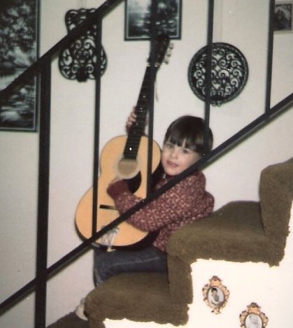 young brian with guitar.jpeg