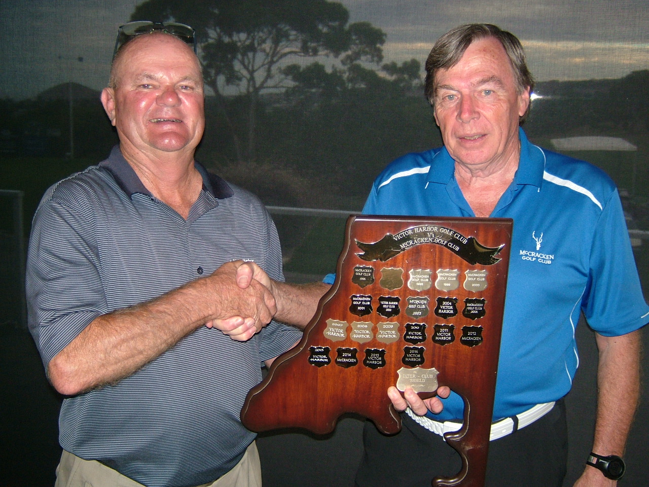 Photos attached show David HOLIS (VHGC Capt – Left) retaining the Men's trophy from John HARTMAN (McCracken Capt)