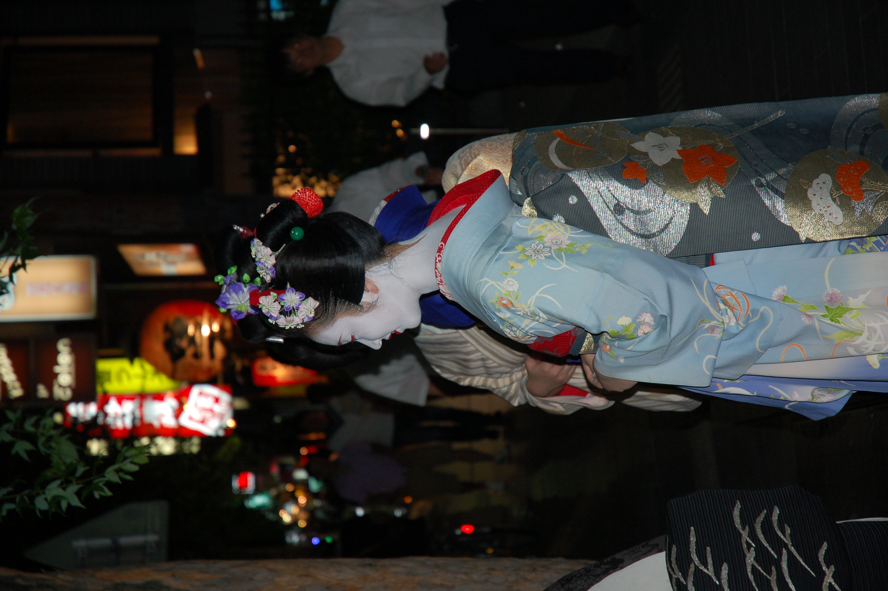 Geishas on the street. Geisha's are not as easy to find as you might hope. We were lucky to spot this group sending off the male patrons. They usually go from their homes to the teahouse in a taxi and stay there until going back home, so you have to catch them traveling between spots. They are not interested in getting their pictures taken and usually hide from prying eyes, but this group was openly standing on the street around a large group of on-lookers.