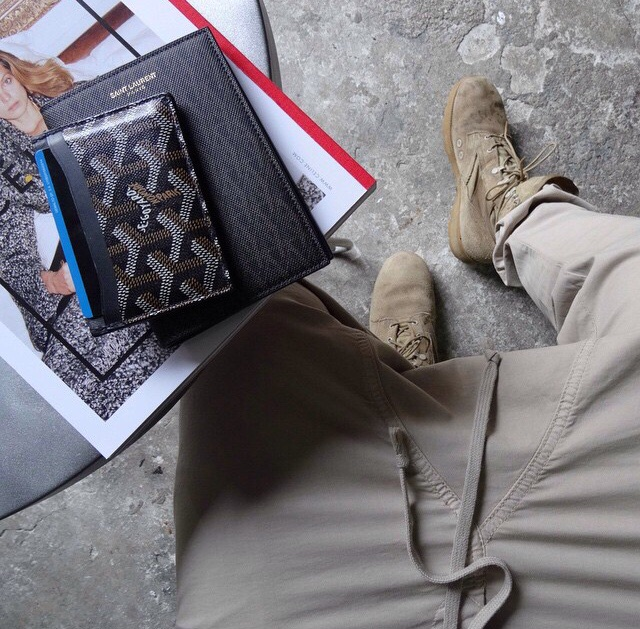 @youthofparis wearing Rick Owens trousers with his boots. Featuring Goyard and Saint Laurent accessories.