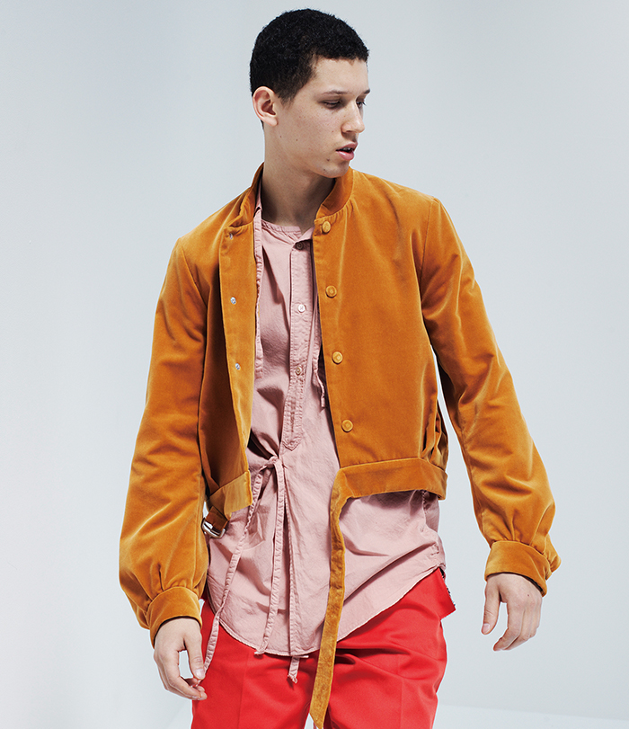 Bed j.w. Ford's SS17 collection showcasing a cropped suede baseball jacket and tunic style shirt with straps