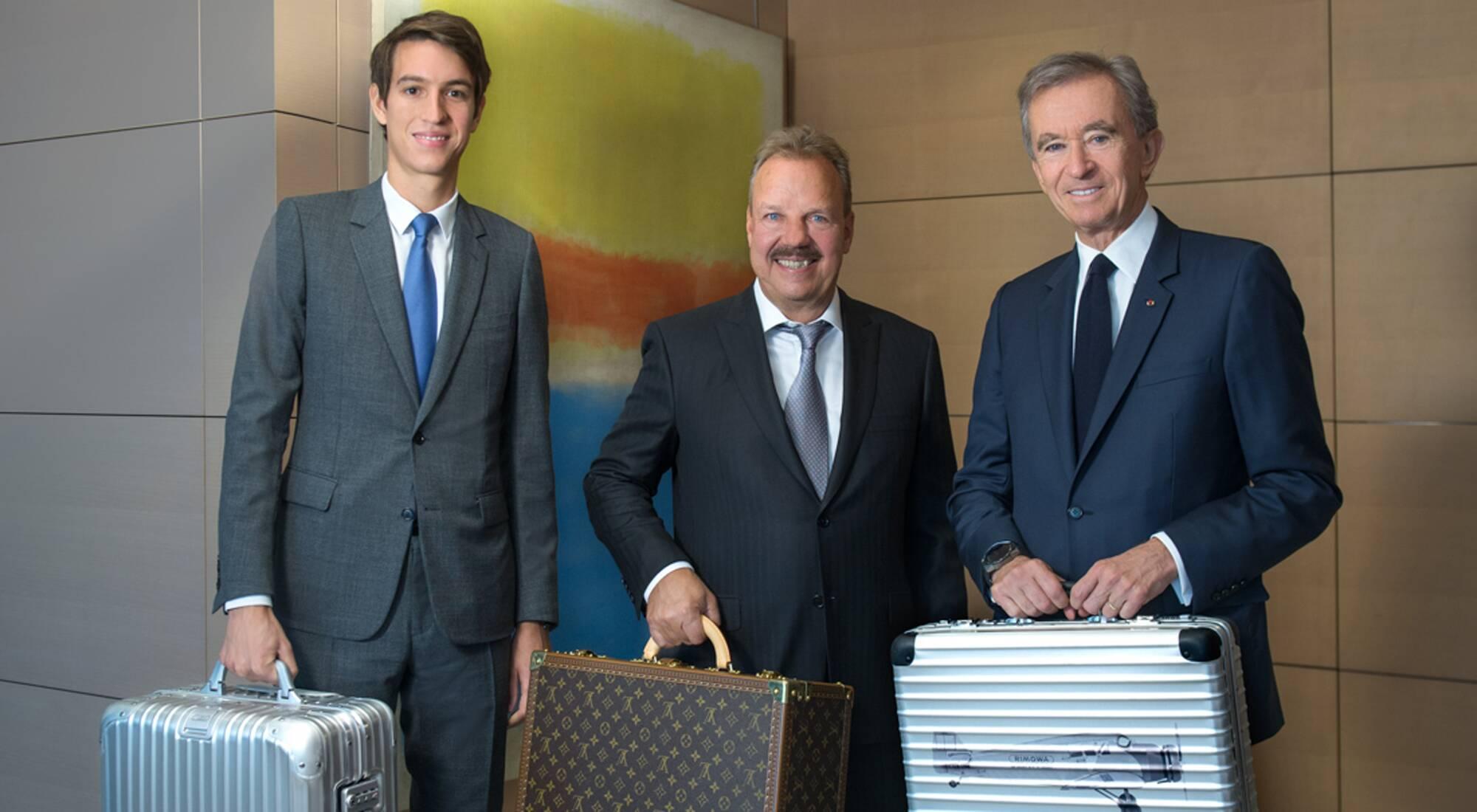 Alexandre Arnault, Dieter Morszeck, and LMVH CEO Bernard Arnault.