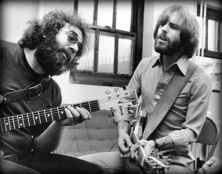 """Jerry Garcia, left, and Bob Weir backstage in 1977, in """"Long Strange Trip."""" Image by Peter Simon."""