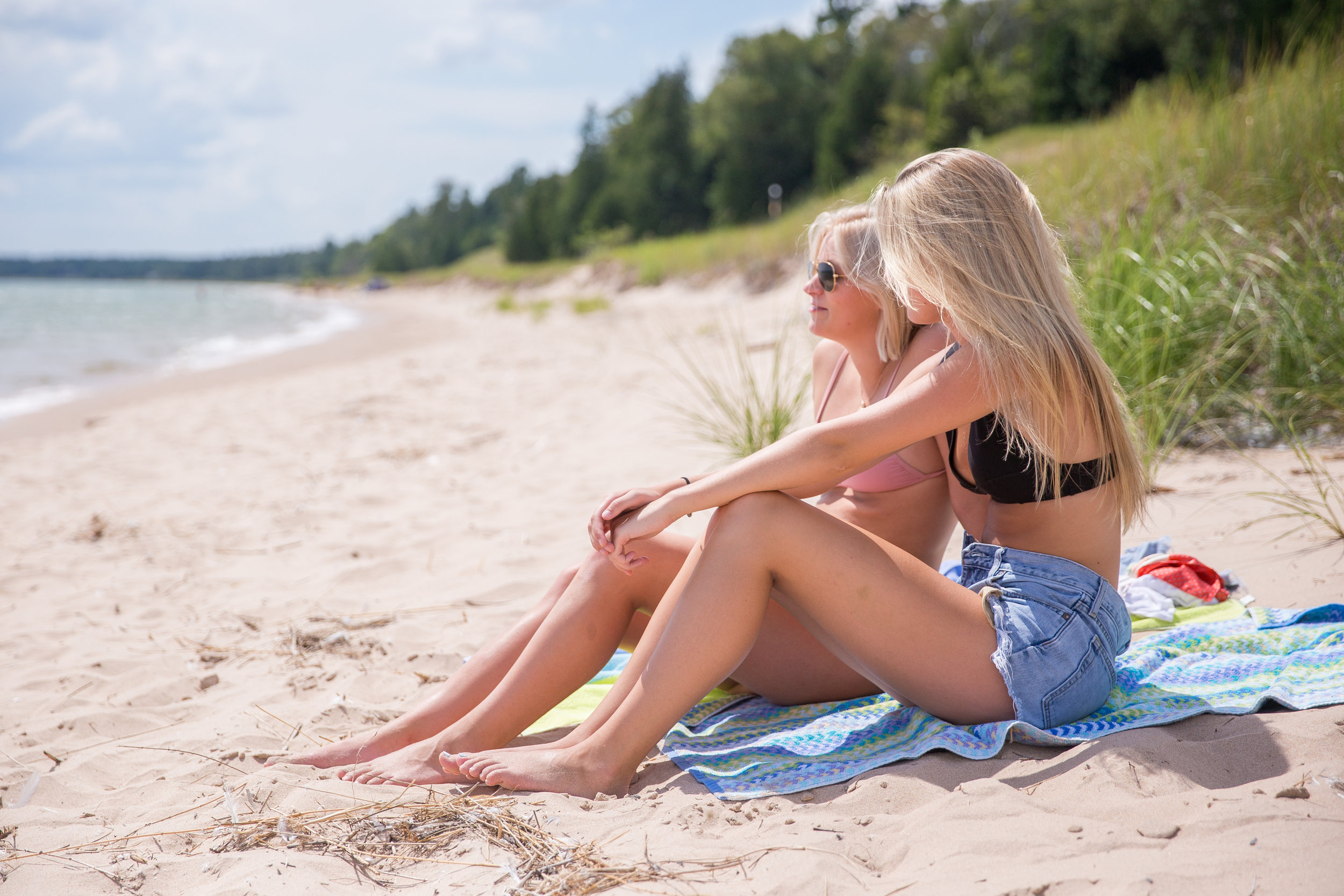 Two young college students home for the summer enjoying Lake Michigan's White Fish Dunes in Door County, Wisconsin.