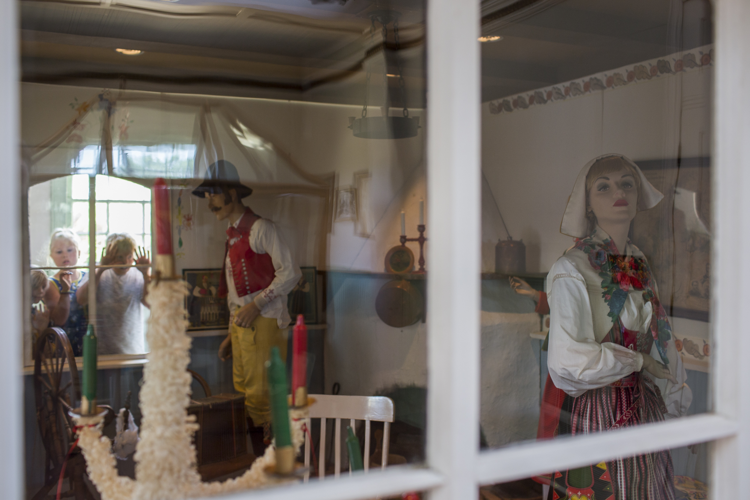 "Swedish-American children look in on a replica portraying a Traditional Swedish 'Stuga', or cottage, informed by the villages of Sweden previous to the emigration to 'Nord Amerika""."
