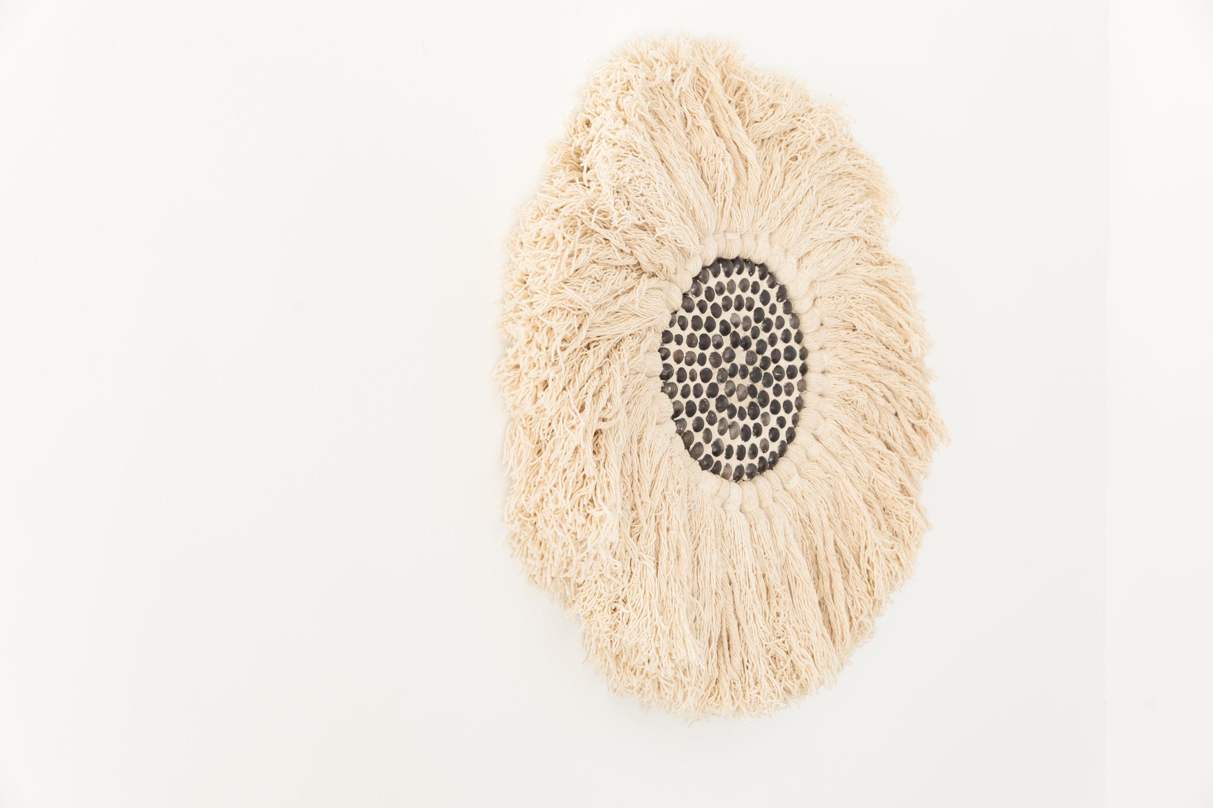 Magic Eye  , 2018, Oaxacan black clay, sand, merino on wood panel, 36 inches diameter