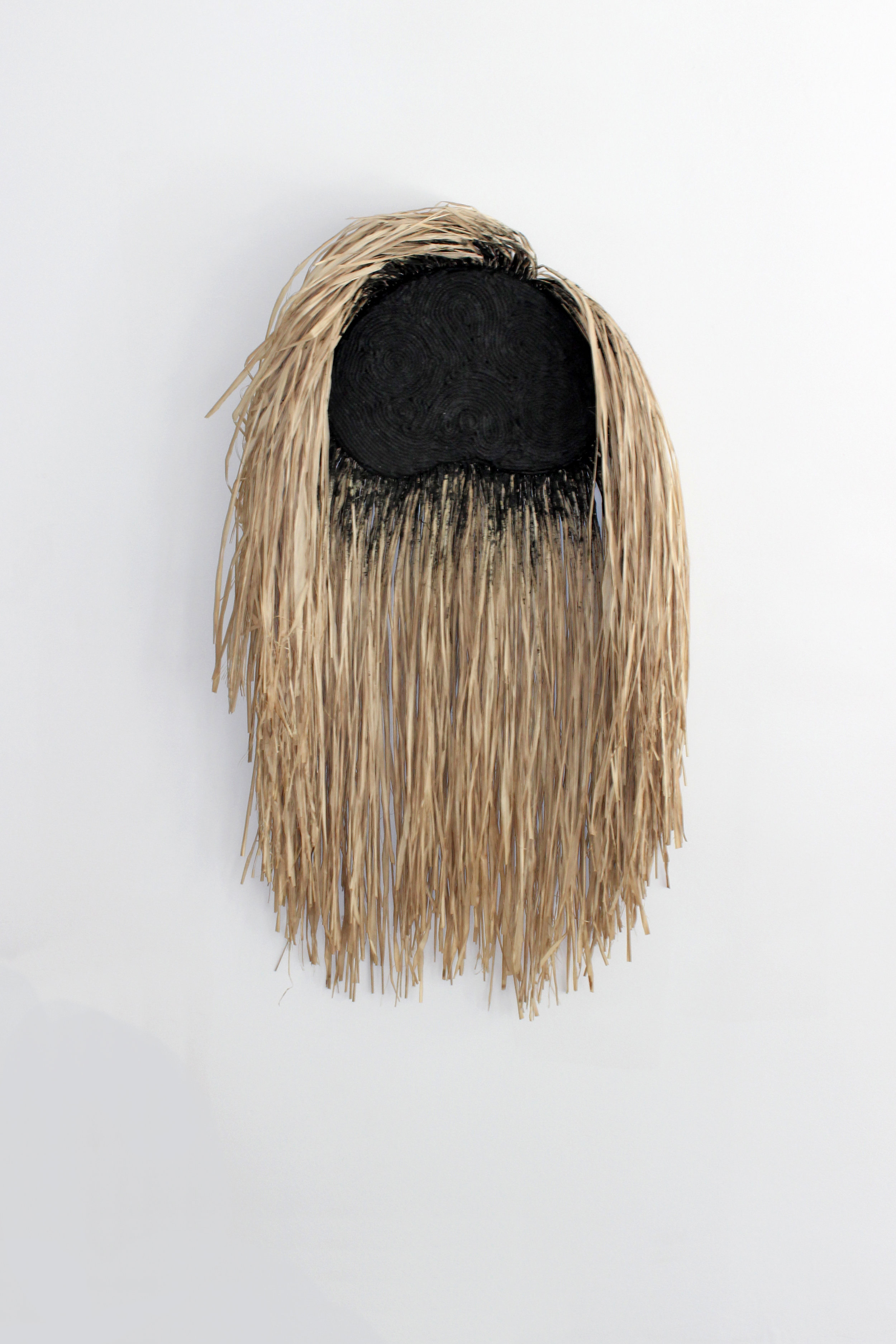 Wildman (black)  , 2019, cotton, raffia, grout on wood panel, 28 x 44 inches