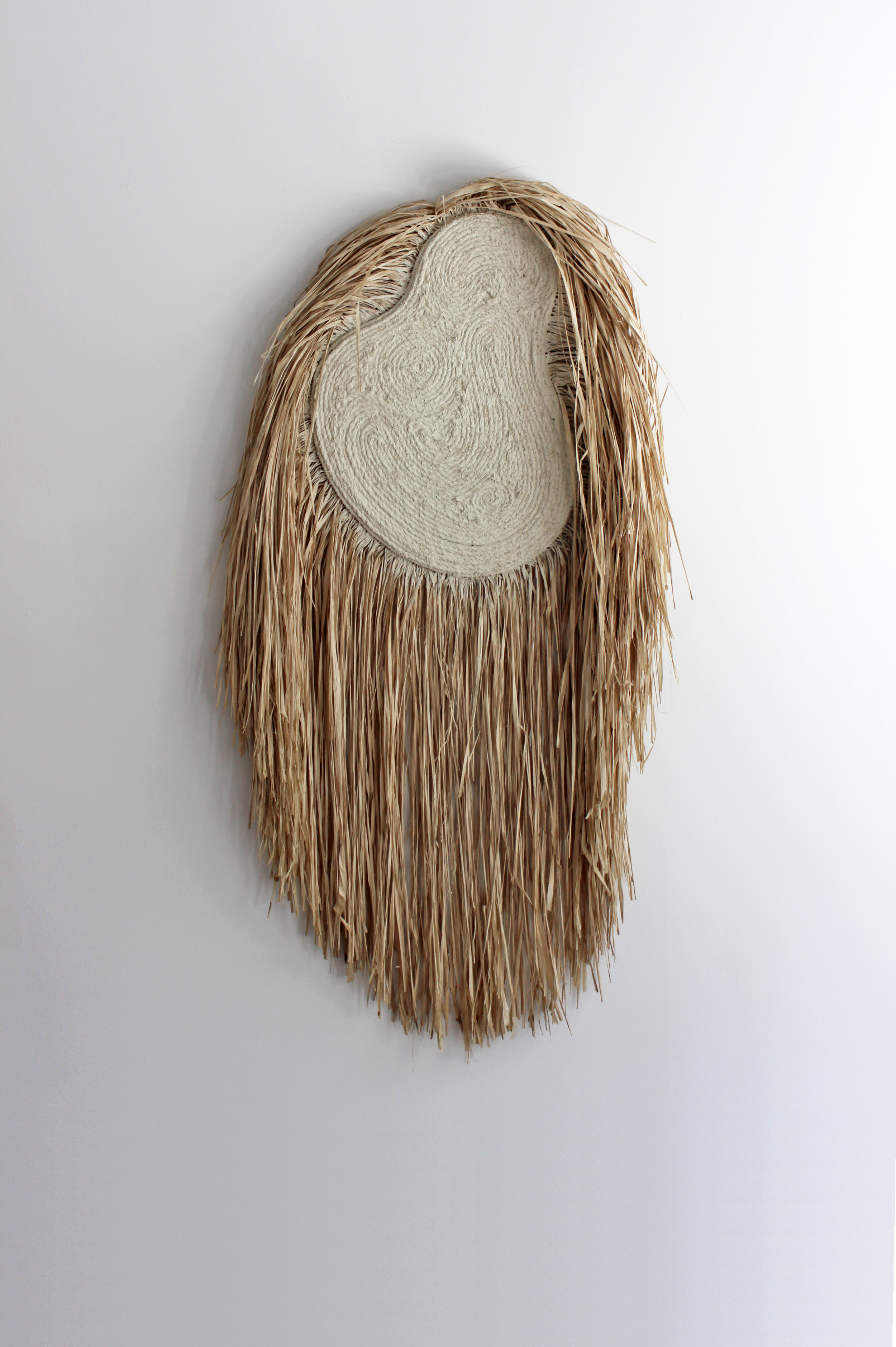 Wildman (white)  , 2019, jute, raffia, grout on wood panel, 36 x 56 inches