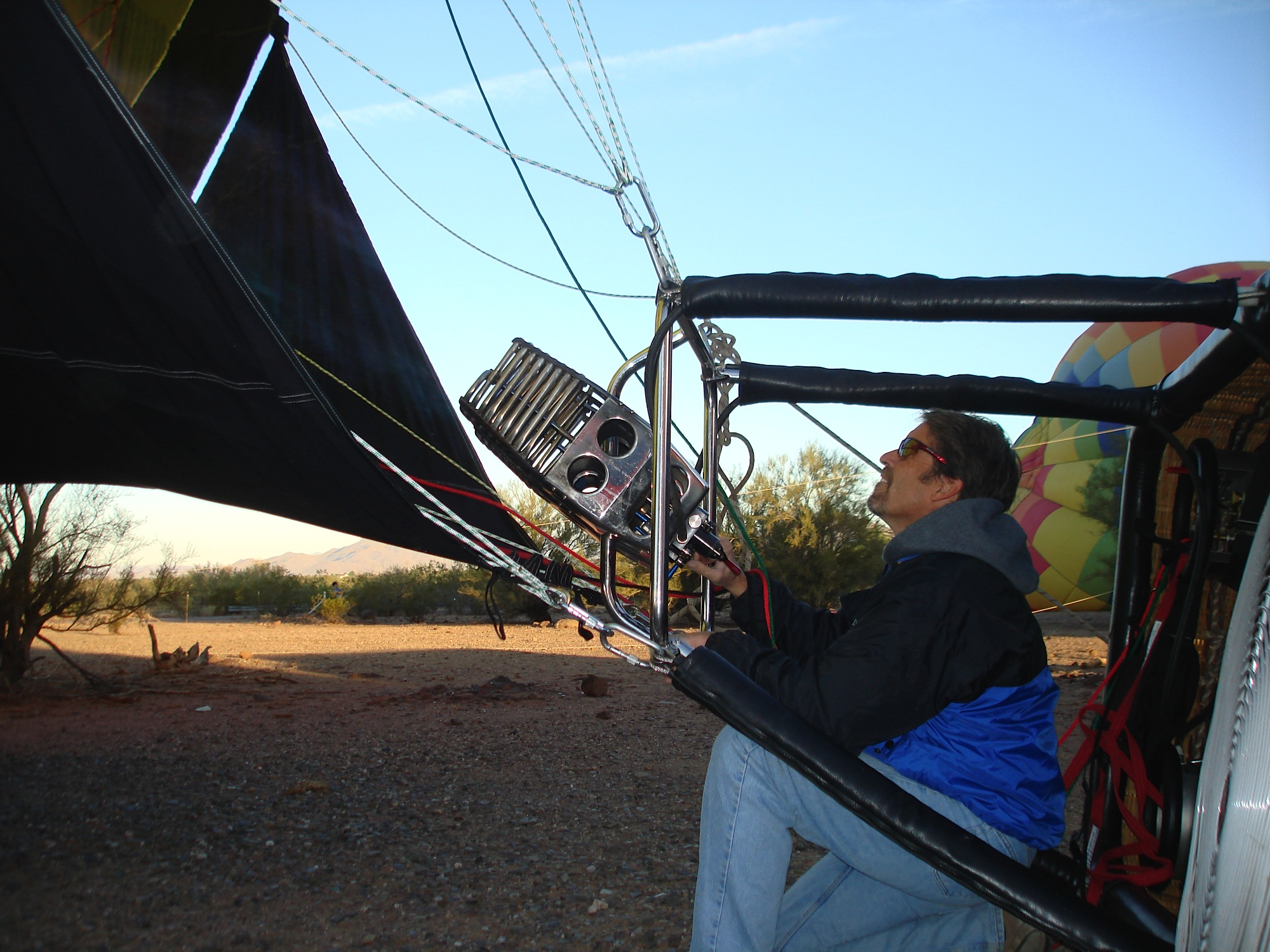 Kevin Flanagan is inflating a hot air balloon before a ride in Phoenix, Arizona.