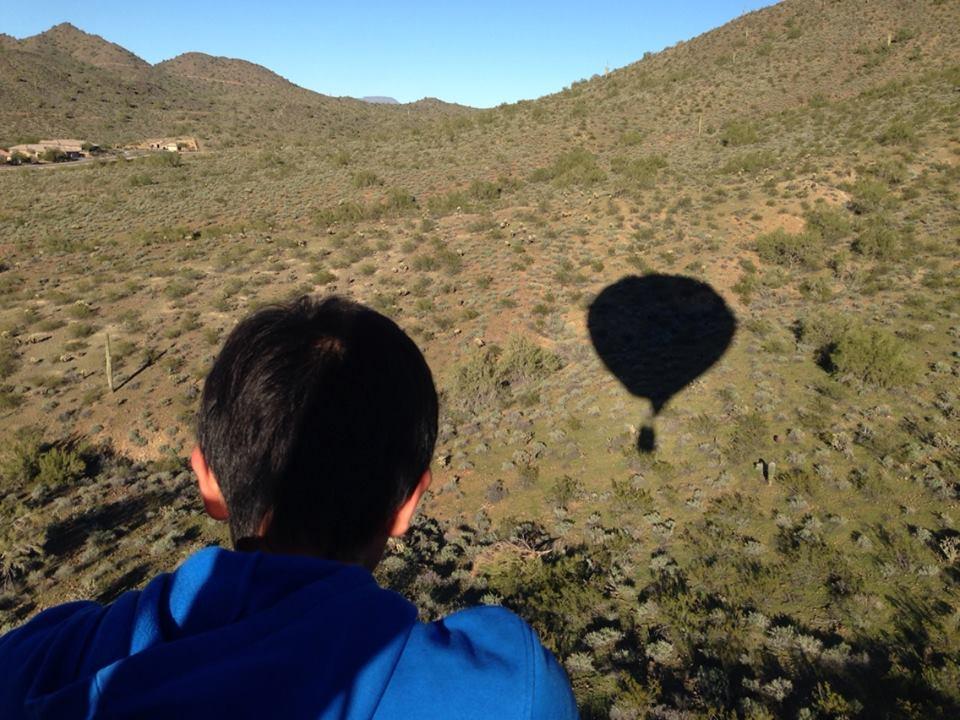 A balloon's shadow on the Phoenix landscape.