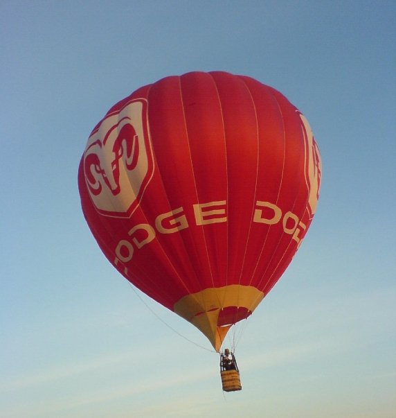 Dodge advertising hot air balloon in flight.