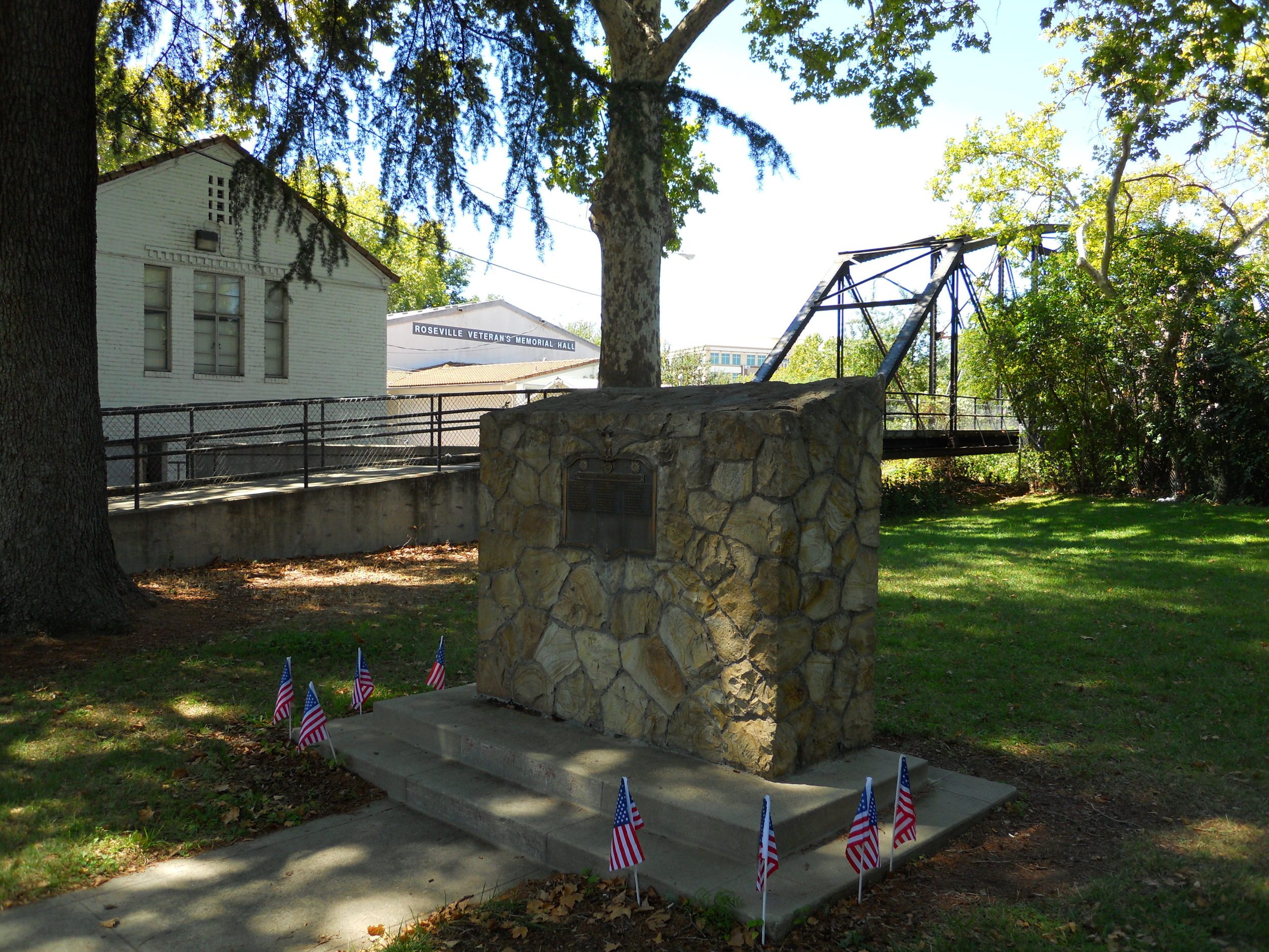 Notice the PFE footbridge, another point of historical interest, behind the monument. The bridge once crossed over the railroad tracks but today it crosses Dry Creek, connecting Royer Park to Oak Street.
