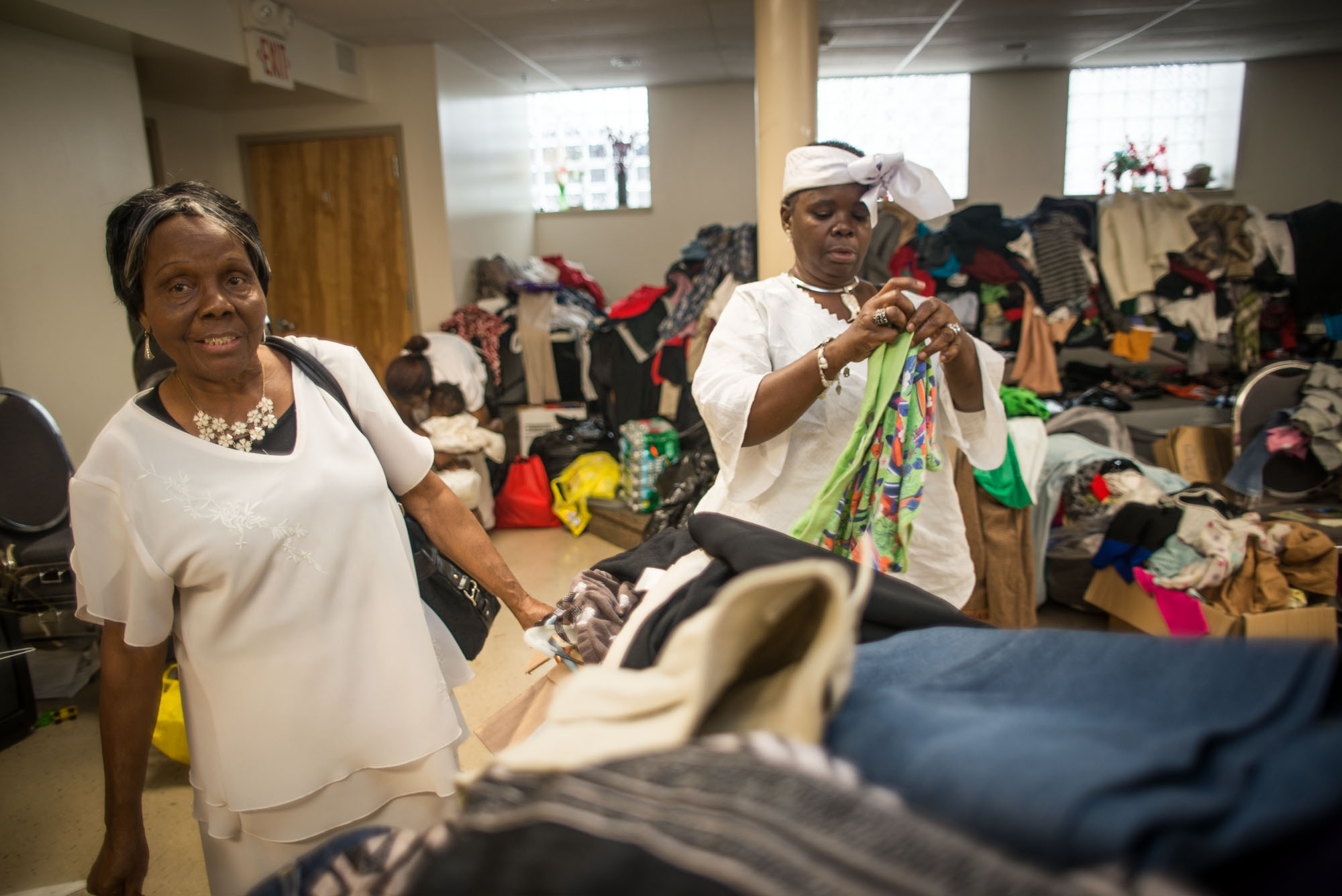 Diana Walker (left) and Roselyn Gray (right) help sort out the donations before they go to the fire victims from las week's fire