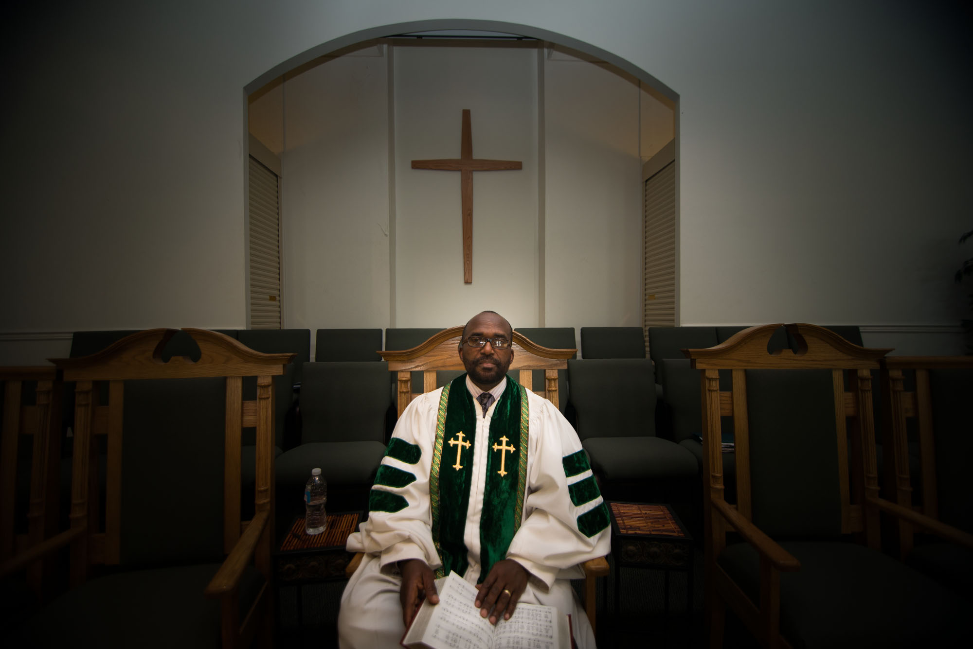 Rev. Napoleon Divine preaches of calm and unity in such a time. He is from Liberia and says that the young people who began the protests and voiced anger at the firefighters for not stopping the fire, are wrong. He wants his community to reach conclusions with city officials side-by-side in a peaceful way.