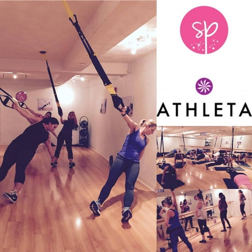 Lauren (in blue) testing her physical limits during an Athleta sponsored TRX event at Studio Poise!