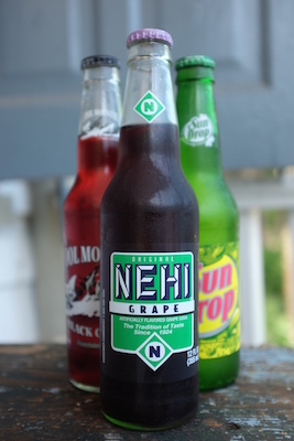 Enjoy an ice cold soda ($1.50) or water ($1.00) with your meal!