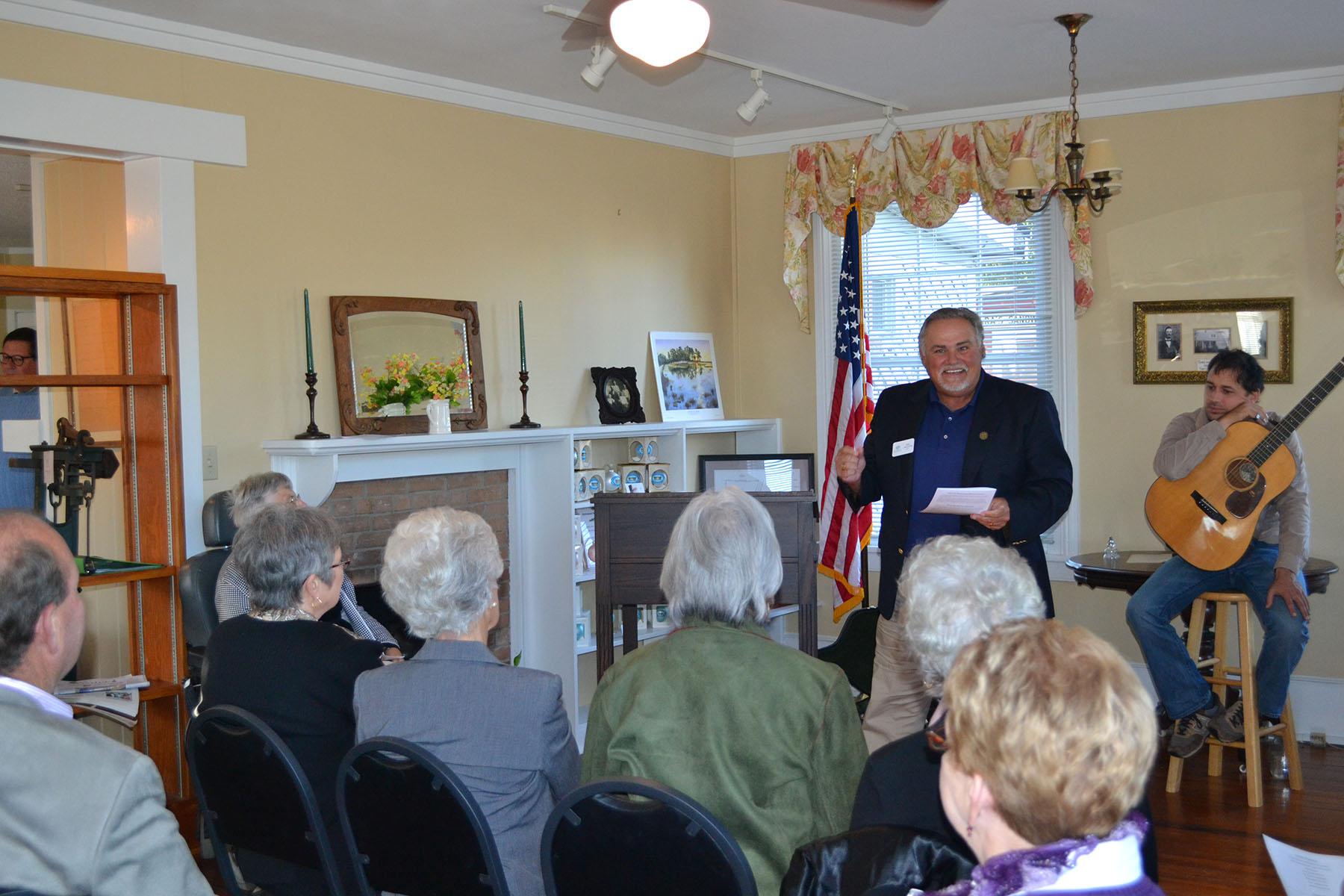 Mayor Ross speaks with Dorothy Blume at Dedication of Clara's Sandwich Shop November 2, 2014.  Photo by: Jim McLean.