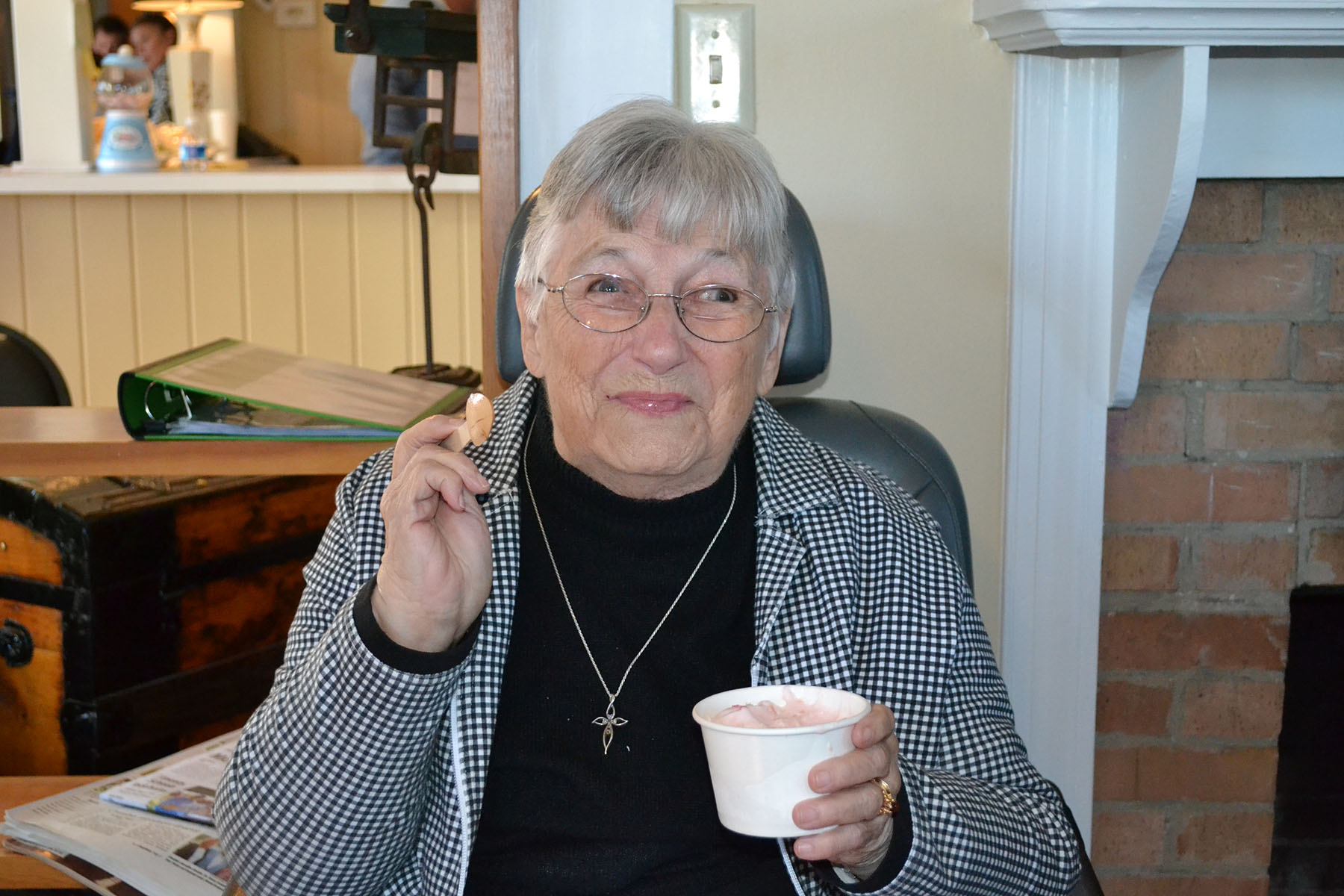 Dorothy Blume enjoys ice cream at dedication of her mothers (Clara) building November 2nd, 2014.  Photo by: Jim McLean.