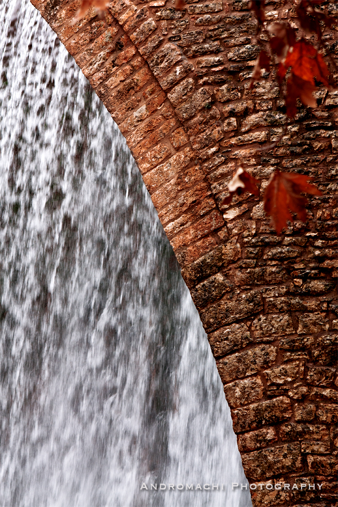 bridge in front of a waterfall, mountains of Greece
