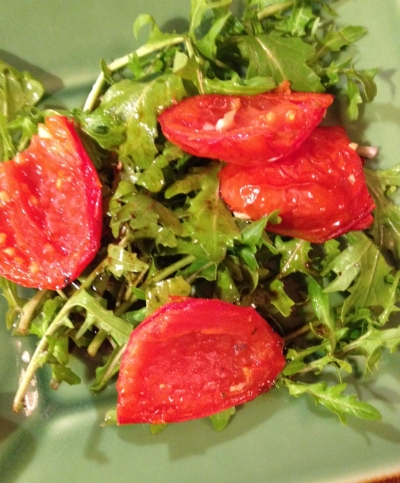 Roasted tomatoes and arugula