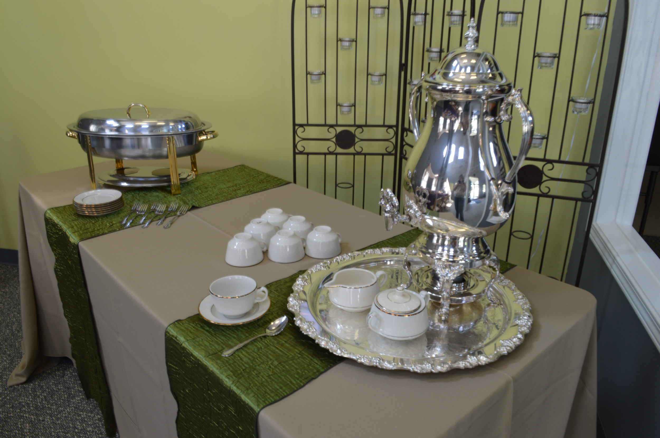 Displayed: Silver Coffee Urn, Gold/ Ivory Rimmed China, Silver & Gold Chafer, Khaki Linen, Sage Runner