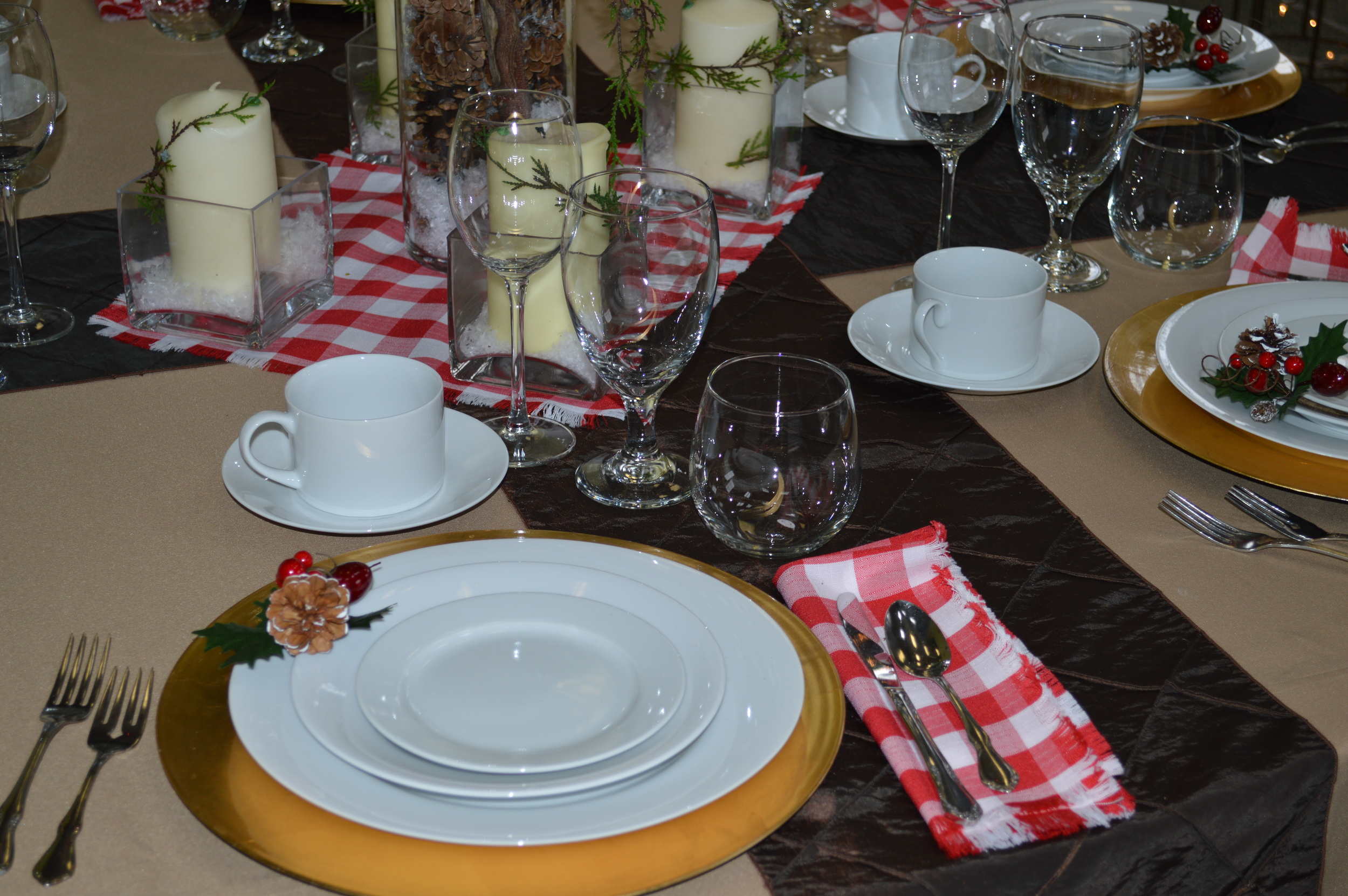 Rustic Christmas Dinner. Featured: White china, Gold chargers, Stemless wine, Water goblet, Plaza wine, Coffee cup, Khaki linen, Brown pin-tuck runner