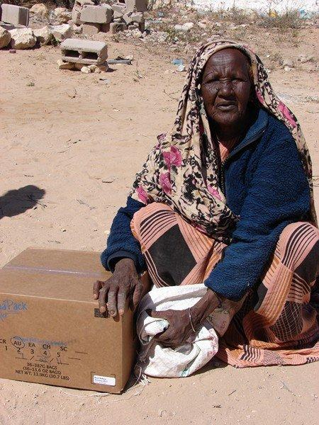 Habiba clung to to her box of food as she agreed to talk to us. She never took her hand off the box during the  interview, as if it is her only possession. She is a 70-year-old from a rural area in Somaliland. There are 5 of her children with her in the camp. She also has a child in the hospital. The pain in her face tells the story of her 3 children and husband who have died. She has been in the camp for the last 5 months and this is the first relief food she has received!