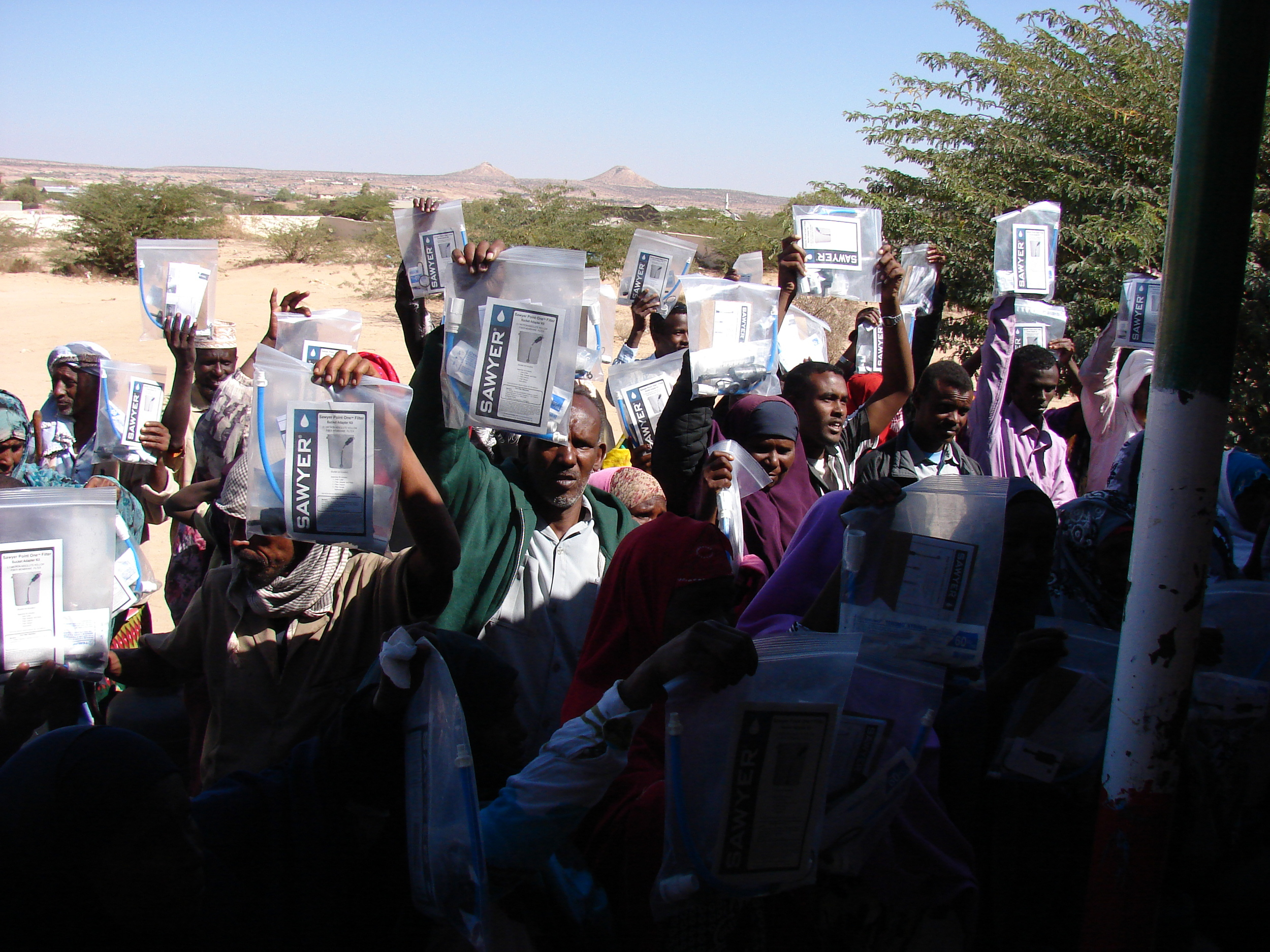 group holding filters in bags.JPG