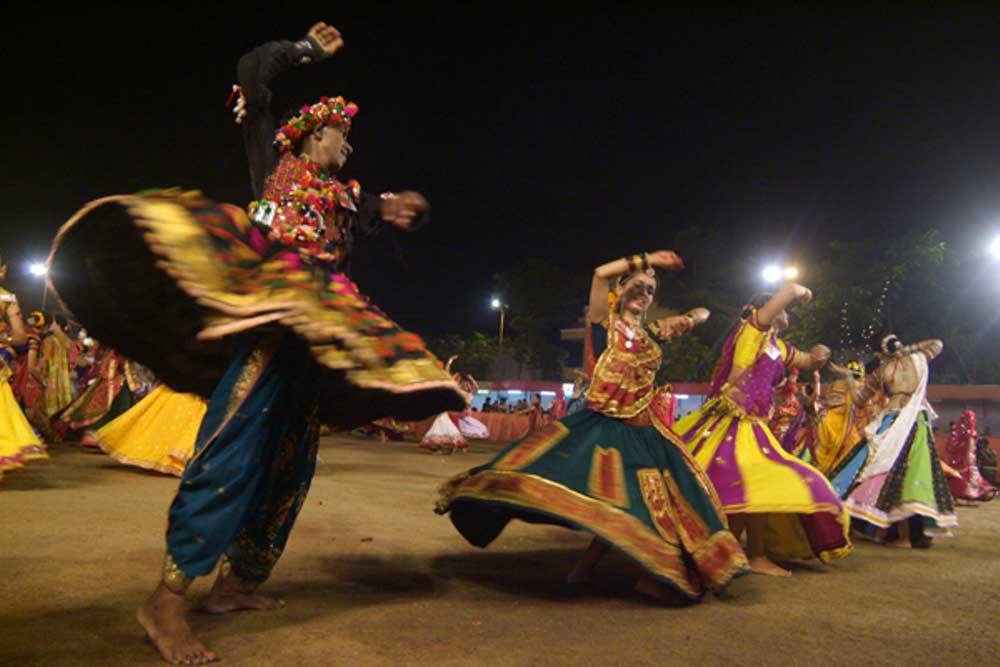 Women and men performing  Garba  as part of  Navaratri  celebrations in  Ahmedabad  photo: Hardik Jadeja