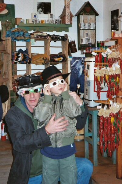 Artist & Client - looking at the world through tinted spectacles.    Madrid, New Mexico
