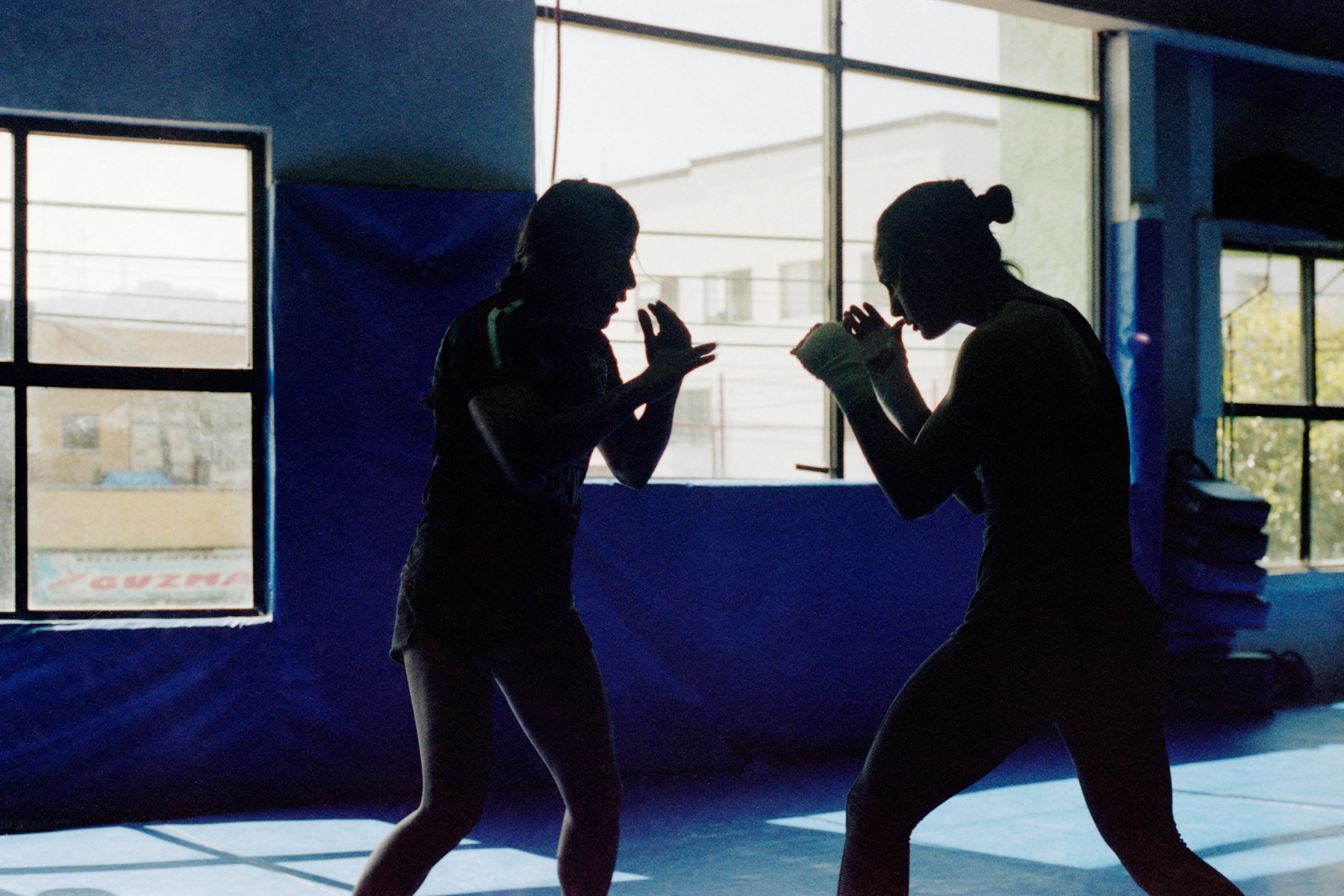 February 27, 2019 - Tijuana, BC, Mexico: Kenia Enriquez, left, practices MMA techniques with jiujitsu champion Yasmin Gutierrez Jauregui, right, at Entram Gym. (Mallika Vora)