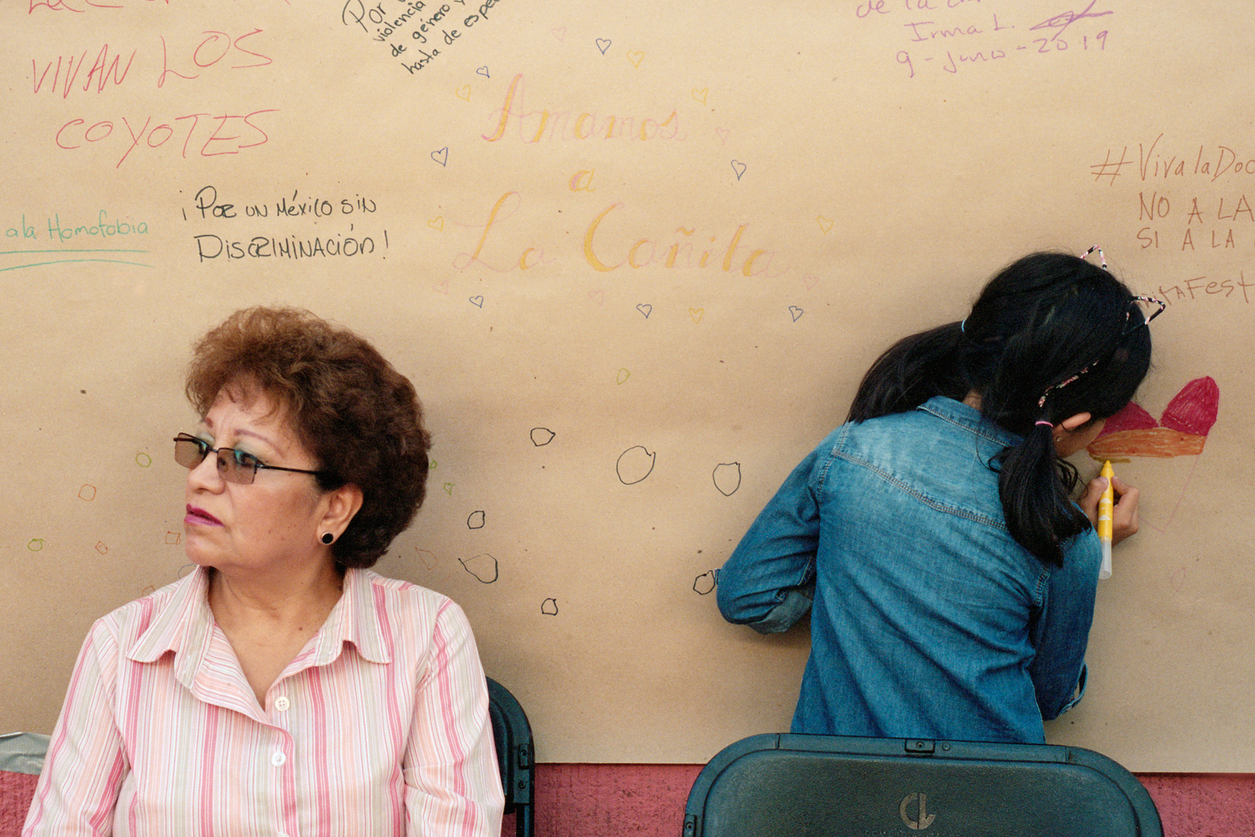 June 9, 2019 - Mexico City, Mexico: Left, Marta Flores, 63, a Doctores resident, in front of a poster where people wrote messages of solidarity with the LGBTQ+ community and support for La Cañita. (Mallika Vora)