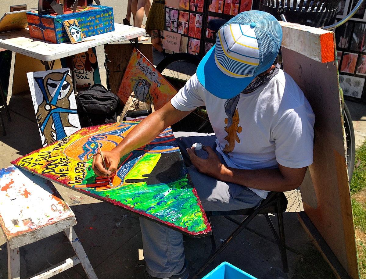 Hugo Gocha, a fellow boardwalk artist painting one of his popular designs