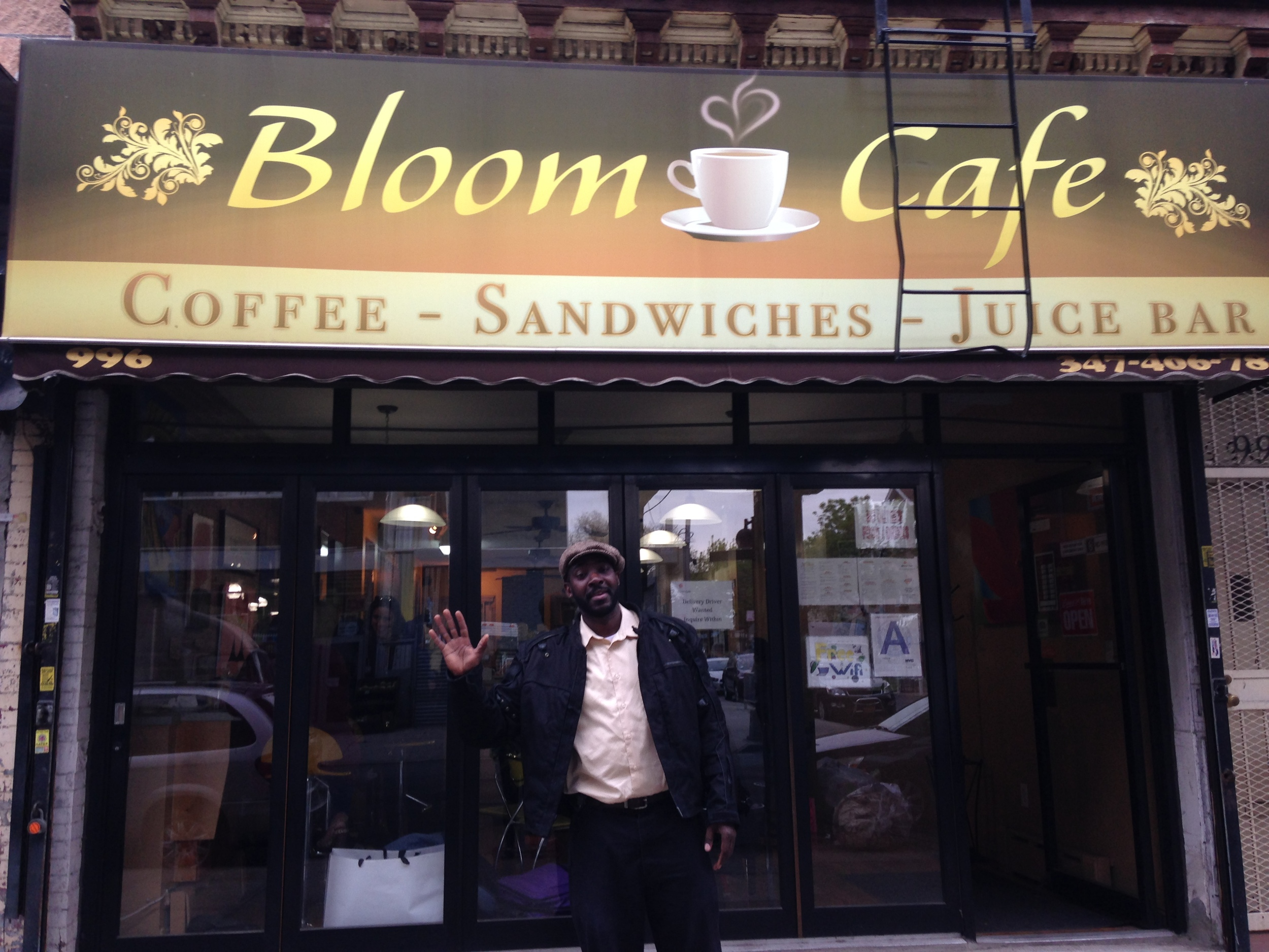 Duane Coates, co-owner of Bloom Cafe, greats newcomers and natives alike.