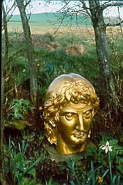 Head of Antoine de Saint-Just doubling as Apollo in Ian Hamilton Finlay's garden at Little Sparta, Scotland.