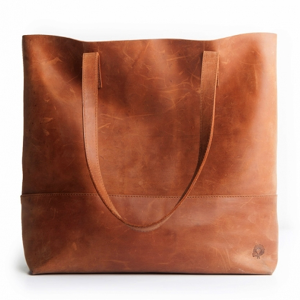 live fashionable   This company makes a beautiful 100% Ethiopian distressed leather tote bag.   FashionAble works with women to help them start small business cooperatives, and they partner with and require manufacturers to also employ women with fair wages and fair hiring practices.     https://livefashionable.com