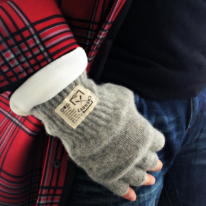 cherry t co   This company makes soft, fully lined hand knitted mittens as well as wool fingerless gloves. These products are made in Canada and the USA.  For every product you purchase, they donate another to a child in need.       http://www.cherrytco.com