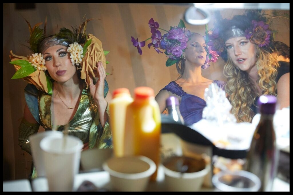 Cricket, Chrysalis and Aja getting ready backstage in our shipping container dressing room.