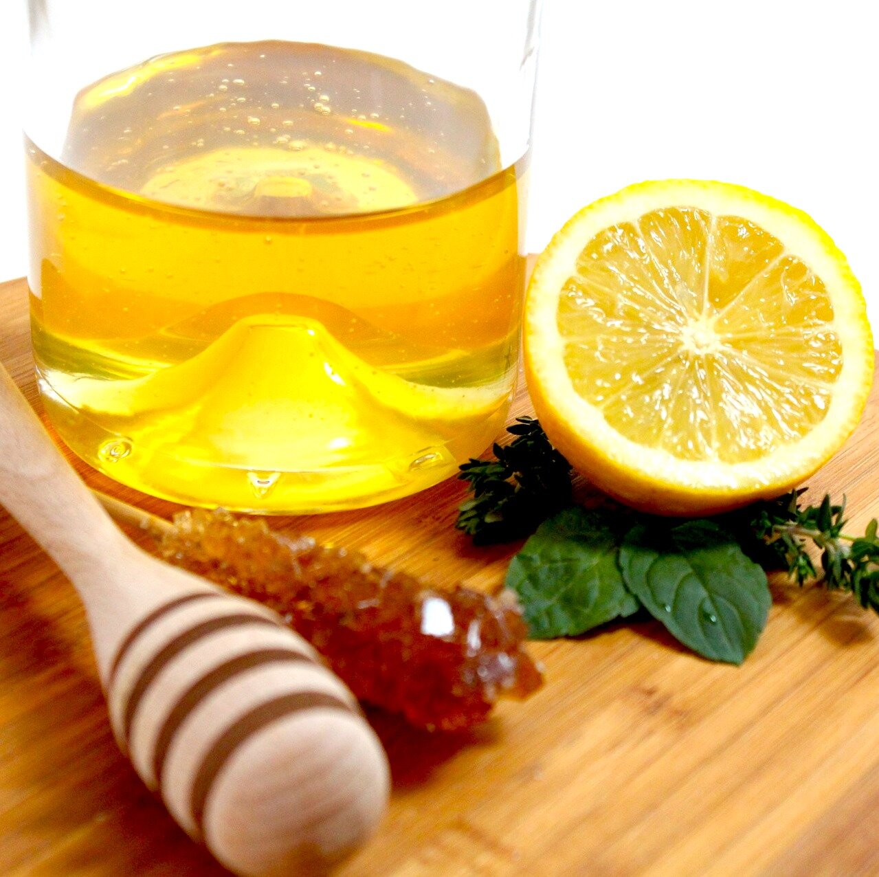 a glass of water with honey, lemon and olive oil every