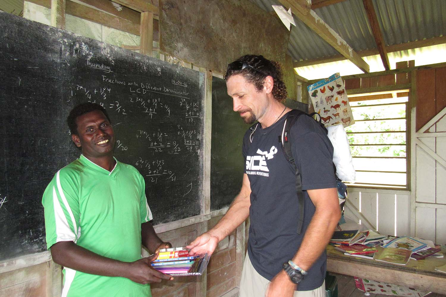 Cruise Director and teacher in schoolhouse at Peava Village