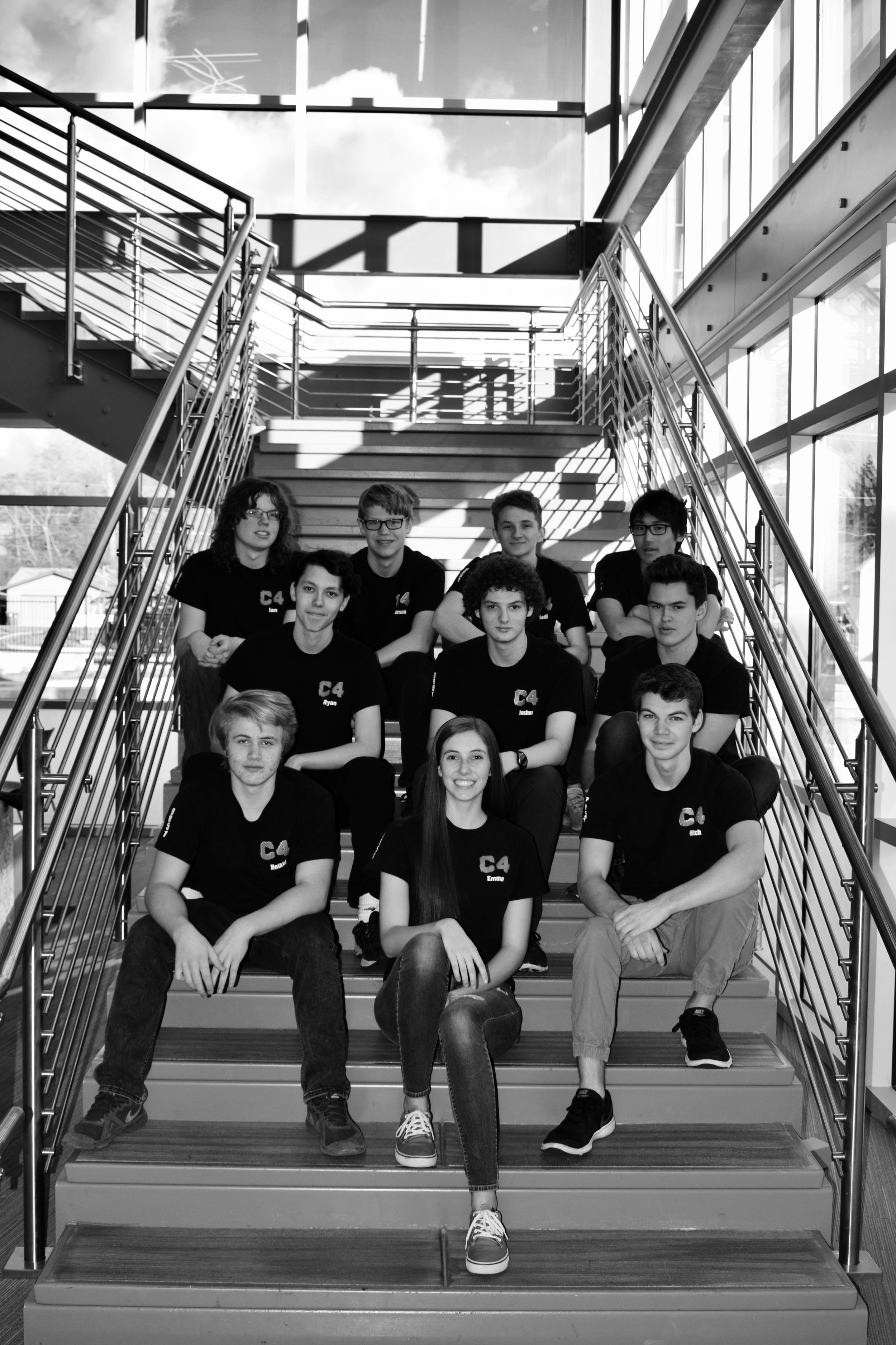 The 2018-2019 team posing on the stairs of the newly constructed STEM center at St. Mary's high school in Medford, Oregon.