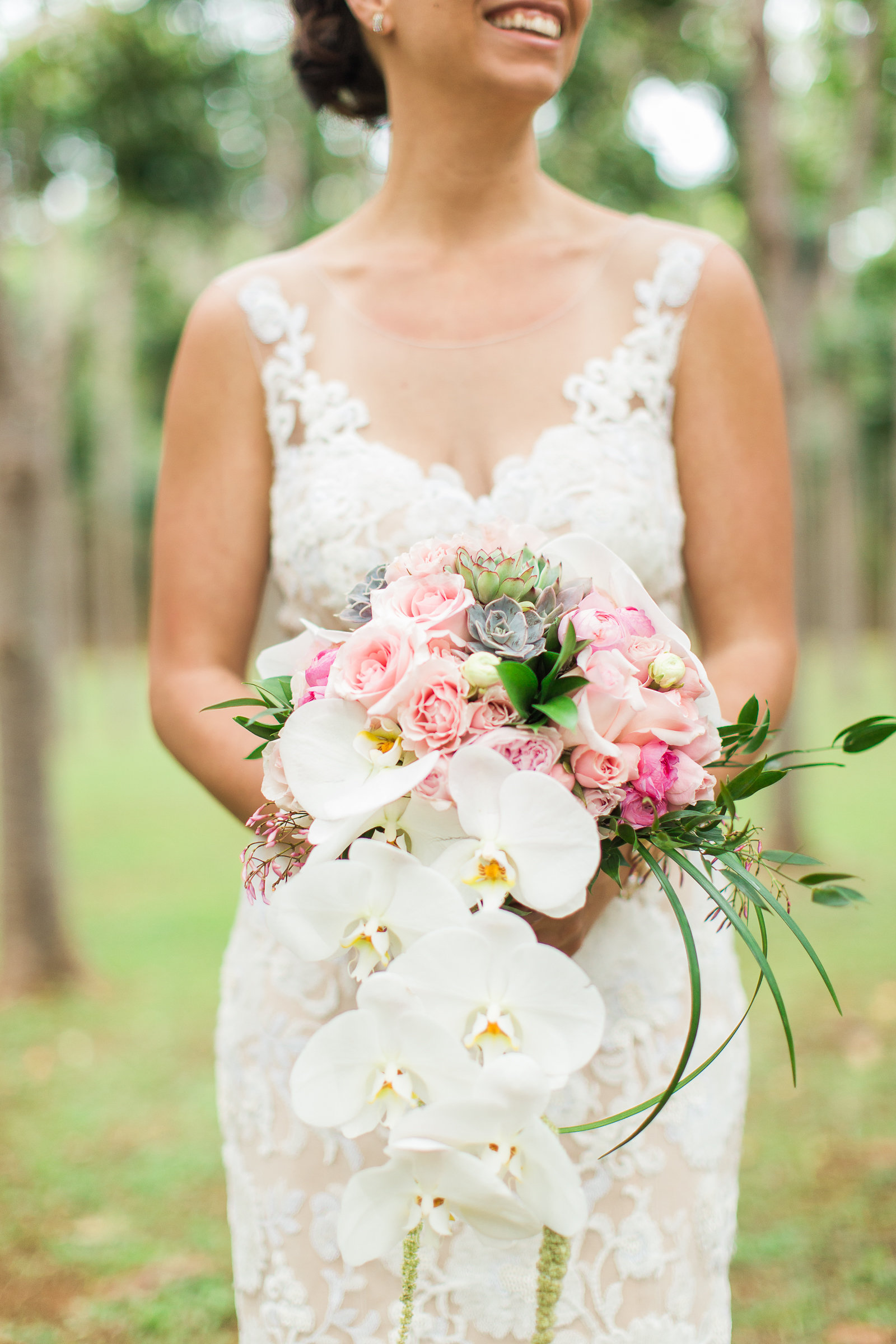 Bridal Bouquet Crafted from Orchids, Pink Roses and Succulents